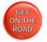 "red button with ""On The Road"" white gradated text"