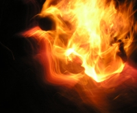 Image of fire, flames in form of a human head profile