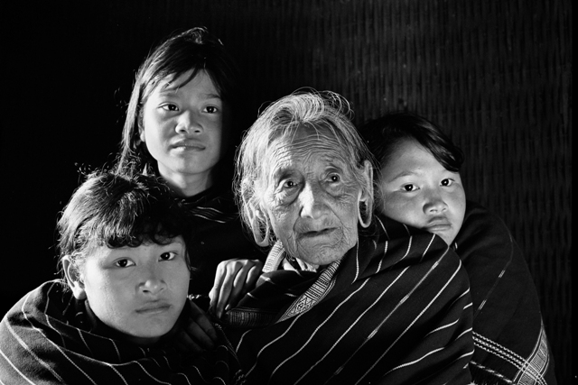 Black and white image of a grandmother and three grandchildren